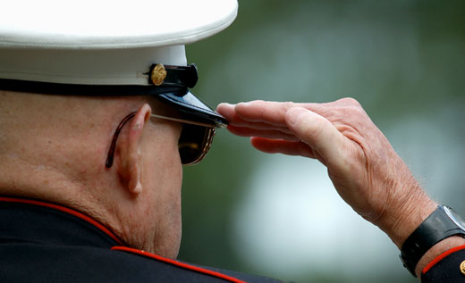 Elderly man doing hand salute